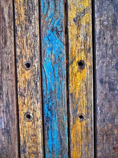 Sunny Old Wooden Table Wooden Table Weathered Weathered Wood Paint Decay Fecay Decay And Dereliction Decaying Wood Decayed Beauty Fresh On Eyeem  Wooden Texture Color Blue Color Yellow Holes Decay Old Wood Weatheredwood Wood Grain