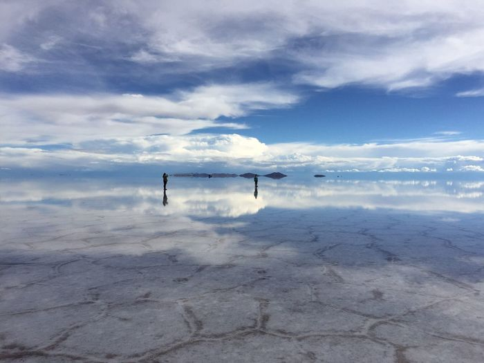 Cloud - Sky Sky Scenics Day Nature Beauty In Nature Real People Outdoors Salt Flat Tranquil Scene Tranquility Standing Men Lifestyles One Person Water Salt - Mineral People Bolivia Uyni,Bolivia Uyuni Uyuni Salt Flat EyeEmNewHere EyeEmNewHere