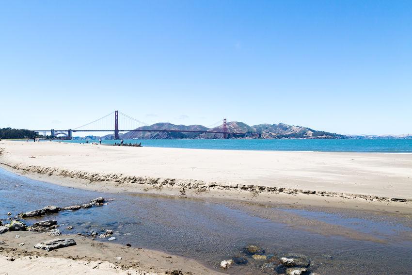 The Golden Gate Bridge Architecture Architecture Beach Beauty In Nature Blue California Clear Sky Crissy Field Day Golden Gate Bridge Nature Outdoors San Francisco Sand Scenics Sea Sky Suspension Bridge Tranquil Scene Tranquility Water