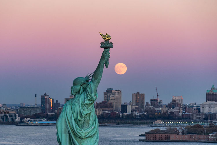 Architecture Building Exterior City Cityscape Fall Metropolis Moon Moonlight New York New York City No People Outdoors Sky Skyline Skyscraper Sunset Supermoon Urban Skyline