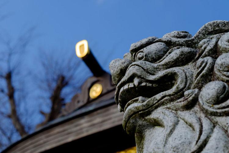 Close-Up Of Dog Sculpture At Japanese Shrine