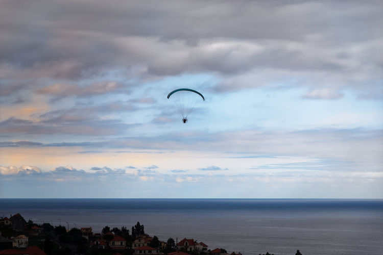 Paragliding at sunset Madeira Sky Sea Water Cloud - Sky Horizon Over Water Horizon Beauty In Nature Scenics - Nature Nature Adventure Parachute Paragliding Sport Extreme Sports Outdoors Tranquil Scene Tranquility Land Sunset Cloudy Sky Freedom