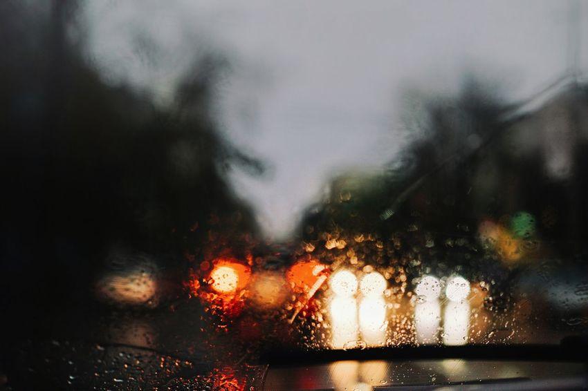 Car Lights View From The Car Windshield Blur Water Tree City Illuminated Car Window Wet Weather Rain Sky Rainy Season RainDrop Drop Torrential Rain
