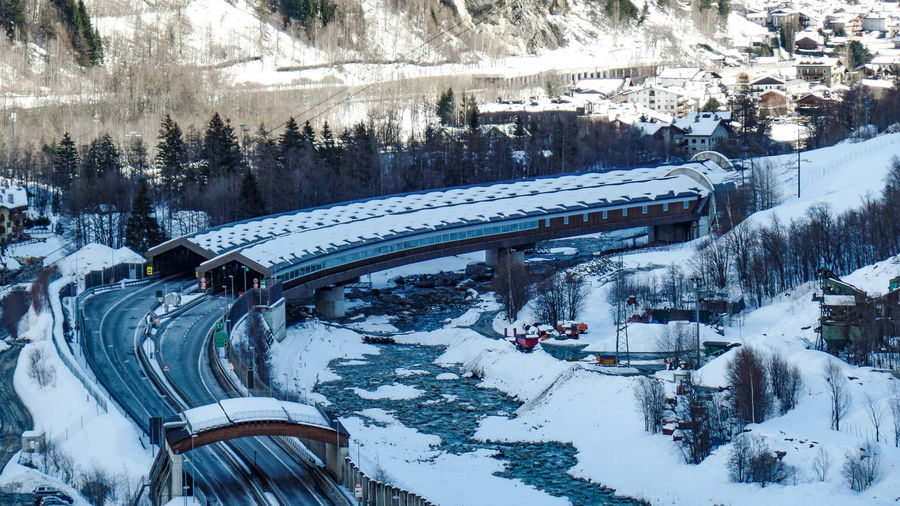 Cold Temperature Winter Snow Architecture Mode Of Transportation Transportation Built Structure Covering Nature Day Train White Color Land Vehicle Building Exterior High Angle View Train - Vehicle Tree Rail Transportation Connection No People Track Snowcapped Mountain