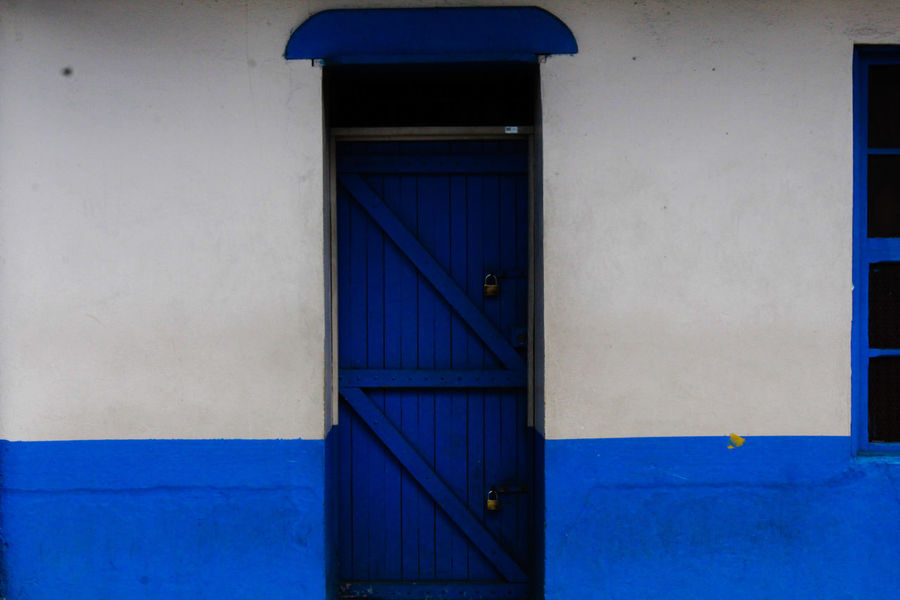 puerta azul del chaque Costa Rica Heredia, Costa Rica Barva Walking Around Walking Around Taking Pictures Streetphotography Blue Wood - Material Protection Door Façade House Safety Entrance Closed Close-up Closed Door Door Knocker Locked Doorway Entryway