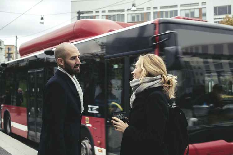 Young couple standing on road in city