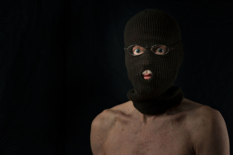 portrait of mature man adult expressive Disguise Adult Adults Only Black Background Filtered Light Front View Headshot Human Body Part Looking At Camera Men One Man Only One Person Only Men People Portrait Riot Shirtless Studio Shot Venetian Blinds Villain Window Light