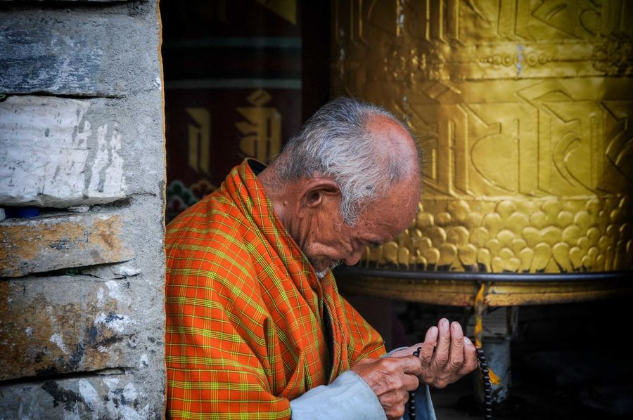 Bhutan Thimphu Thimphu Adult Adults Only Concentration Day Human Hand Men Occupation One Man Only One Person One Senior Man Only Only Men Outdoors People Prayer Wheels Real People Senior Adult Senior Men Skill  Temple Working