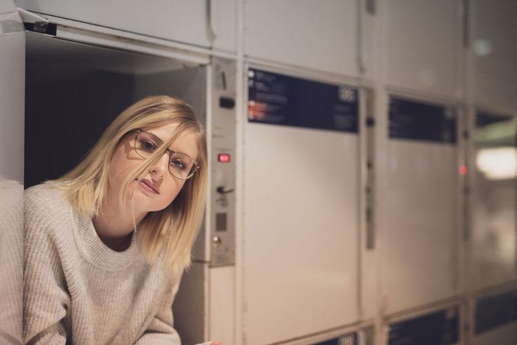 Portrait Of Young Woman In Locker