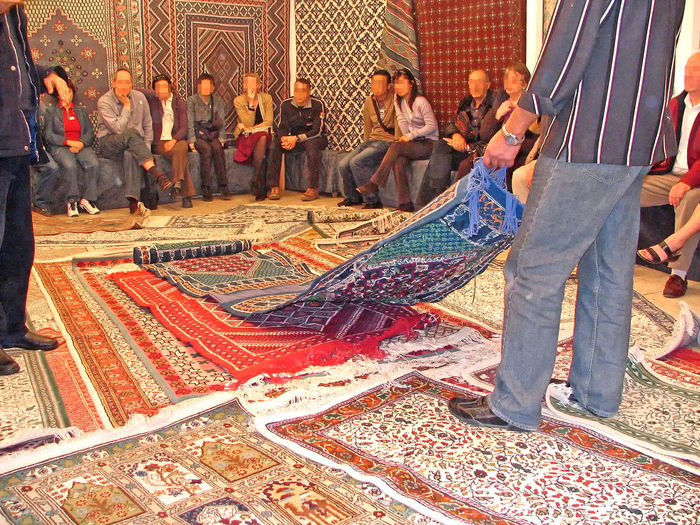 A taste of Tunisia A Taste Of Tunisia Tunis Adult Adults Only Carpet Salesmen Carpet Store In Tunis Day Indoors  Large Group Of People Lifestyles Men Only Men People Real People Rug Selling Carpets Business Stories