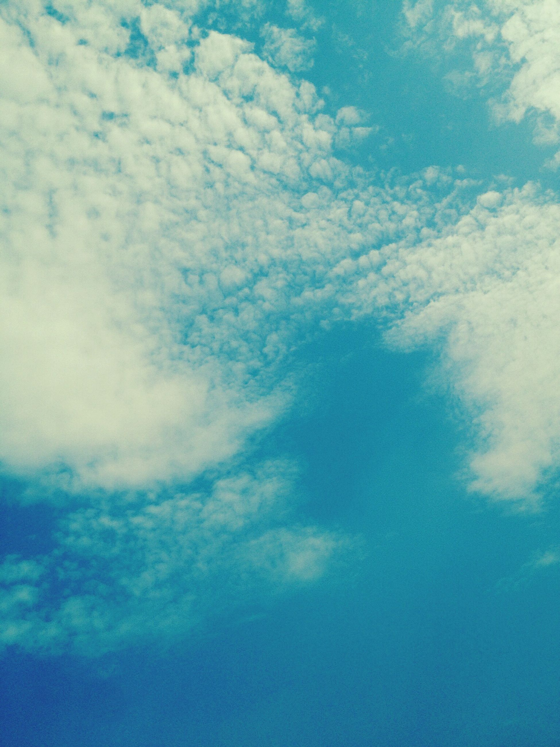 sky, low angle view, blue, cloud - sky, beauty in nature, tranquility, cloudy, scenics, nature, sky only, tranquil scene, backgrounds, cloud, cloudscape, full frame, idyllic, outdoors, day, no people, white color