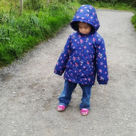 One little girl walking downhill. Full Length Childhood One Person Real People Portrait Babies Only Warm Clothing EyeEmNewHere Toddler Girl Preschool Age Childhood Innocence Autumn In Ireland Childhood Joy Childhood Fun Enjoyment Family Vacation Standing Child Children Only Baby Preschooler Walking Down The Hill Sulking Looking Down Looking Cute
