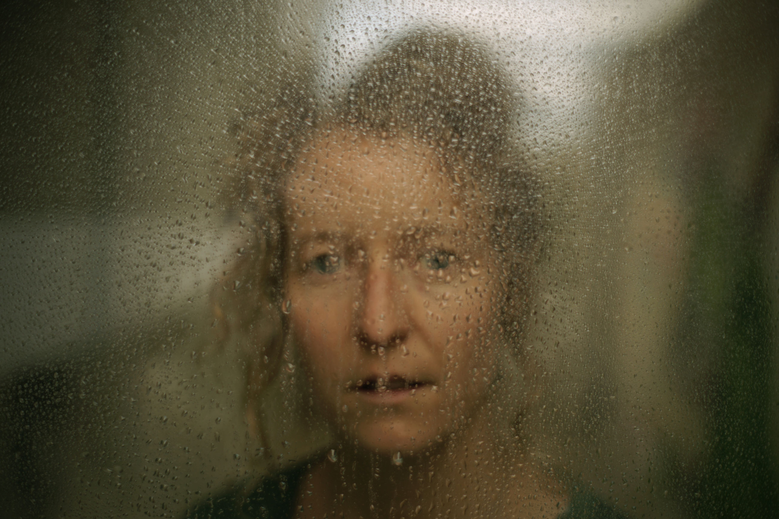rain, wet, drop, window, glass - material, water, sadness, loneliness, depression - sadness, raindrop, one person, indoors, looking at camera, weather, front view, portrait, looking through window, frosted glass, headshot, close-up, one woman only, beautiful woman, only women, shower, adults only, day, adult, one young woman only, young adult, people