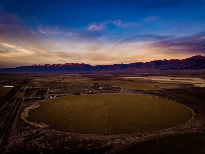 Crop Circle Drone  Farm Beauty In Nature Cloud - Sky Crop Circles Day Dronephotography Farming Landscape Mountain Mountain Range Nature No People Outdoors Scenics Sky Star - Space Sunset