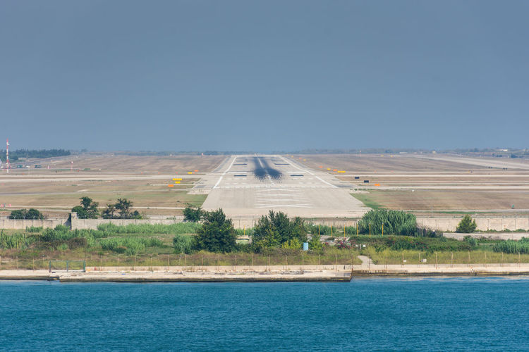 Airplane Airport Runway Blue Clear Sky Day Nature No People Outdoors Scenics Sky Water