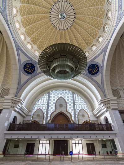 Masjid Wilayah Persekutuan Arch Architectural Feature Architecture Built Structure Ceiling Domes Famous Place Indoors  Islam Islamic Architecture Islamic Design Low Angle View Majestic Masjid Masjid Wilayah Persekutuan Mosque Ottoman Place Of Worship Prayer Religion Spirituality