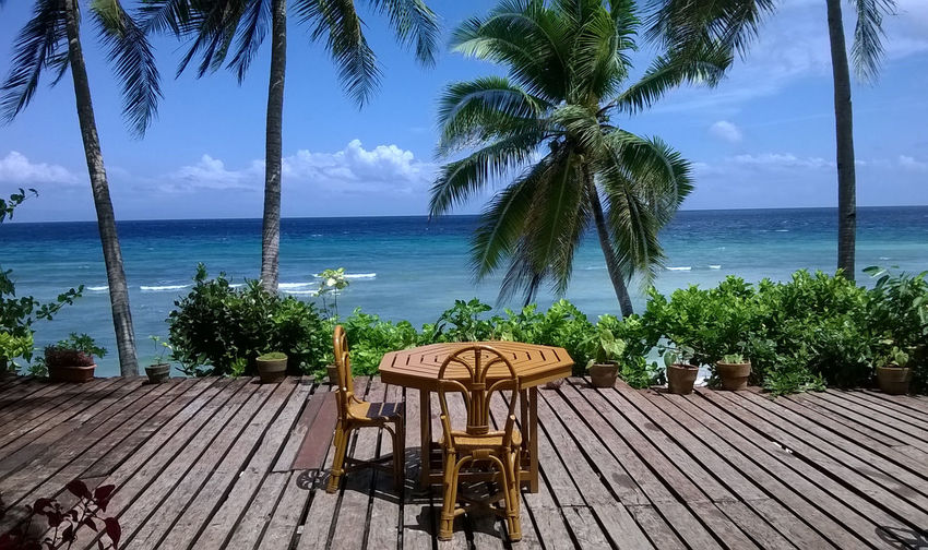 Place setting in front of tropical beach