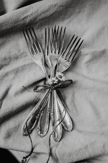 High angle view of forks on table