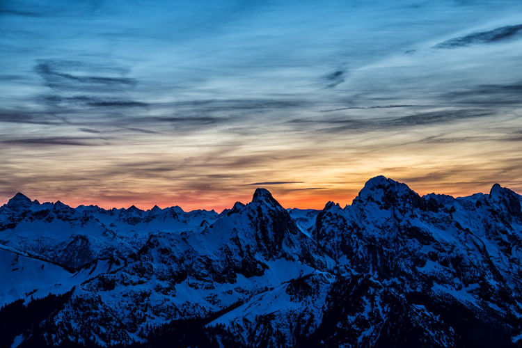 Sunset in the snowy alps Scenics - Nature Snow Beauty In Nature Winter Cold Temperature Sky Mountain Sunset Tranquil Scene Tranquility Cloud - Sky Mountain Range Idyllic Nature No People Snowcapped Mountain Mountain Peak Non-urban Scene Environment Formation Alps Tyrol Austria