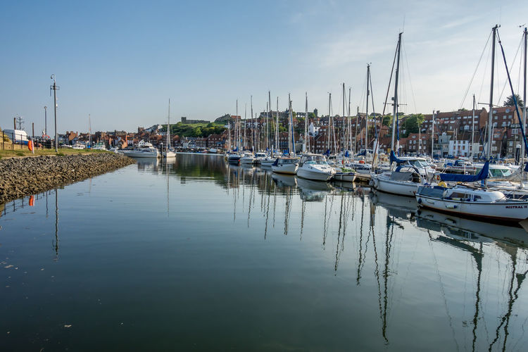 Whitby Whitby Harbour Whitby View Whitby North Yorkshire North Yorkshire Yorkshire Tourist Destination Sunny Day Blue Sky Seaside Seaside Town Nautical Vessel Waterfront Harbor Sailboat Reflection Marina Moored Port Yacht Outdoors Transportation No People Sky Water