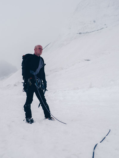 Low Angle View Of Hiker Standing On Snow