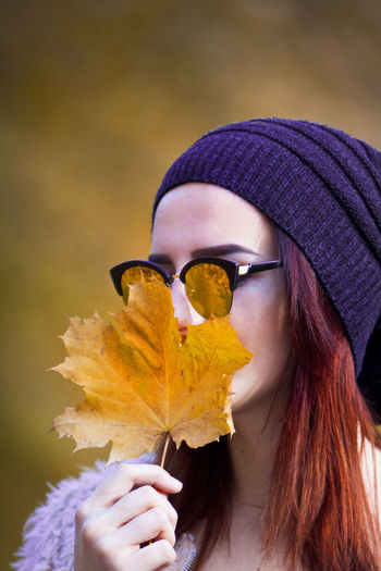 Woman Holding Dry Leaf