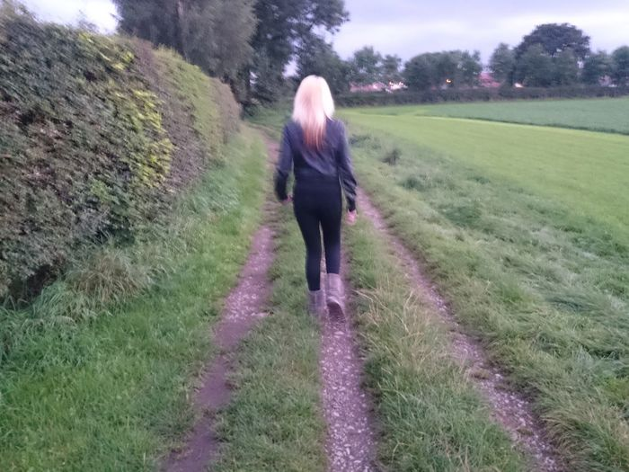Blonde Women Walking Grass.frack Fields Rear View Real People One Person Green Color Beauty In Nature Women Track Gate Wife On A Mission People Adult Leisure Activity Lifestyles Tree Grass Day Outdoors Nature