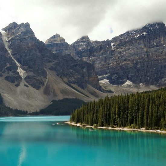 Magnificent Moraine Lake 😍 Landscape Scenics Travel Travel Destinations Water Lake Mountain Idyllic Outdoors Cloud - Sky Tranquil Scene Nature Tree Forest Vacations Beauty In Nature Sky No People Day Moraine Lake  Canada Canadian Alberta Turquoise Water
