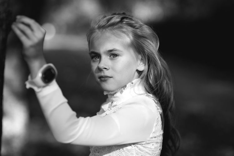 Little Girl Face Long Hair Serious Cute Hand Portrait Blackandwhite One Person Looking At Camera Real People Waist Up Standing Hairstyle Holding Child Headshot Girls Beautiful Inspiration Elementary Age Student Teenager