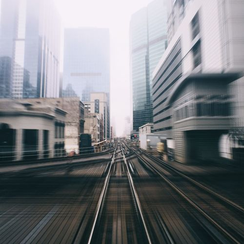 Blurred view of railroad track passing through downtown district