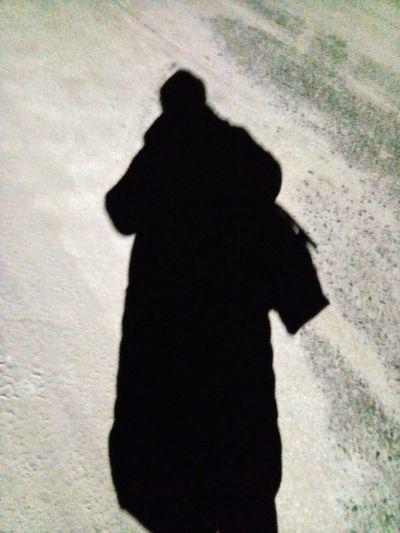 Shadow of people on street