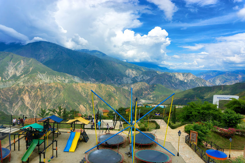 CHICAMOCHA CANYON, COLOMBIA - MAY 8: View of a playground in Chicamocha Canyon, Colombia in Panachi park on May 8, 2016 Adventure Bucaramanga Canyon Chicamocha Cliff Colombia Destination Holiday Landmark Landscape Mountain National Park Nature Outdoors Panachi Playground Rock Santander Scene Slide Slides Tourist Trampoline Travel Valley