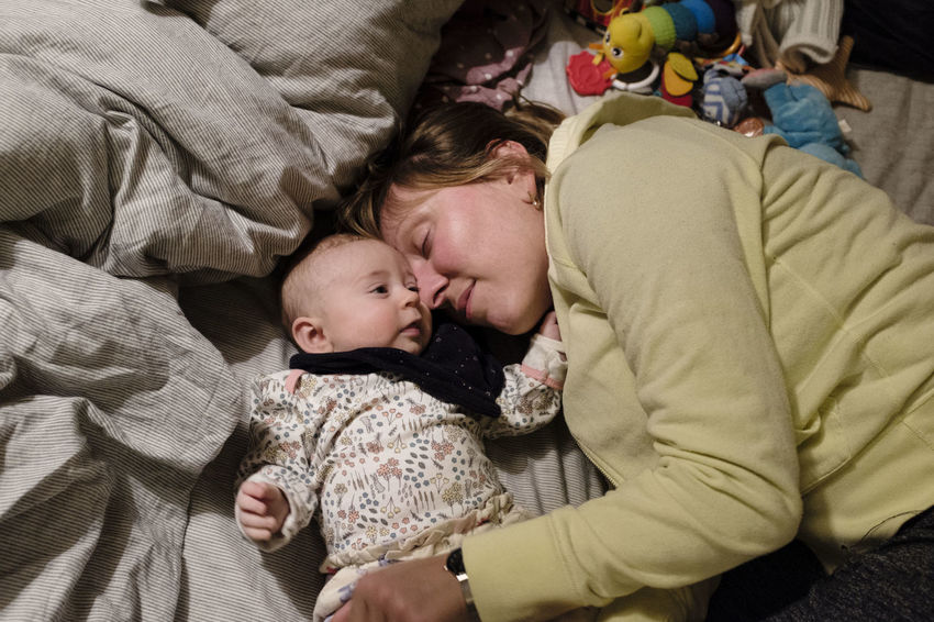 Adult Baby Babyhood Bed Bedroom Bonding Childhood Close-up Comfortable Day High Angle View Indoors  Innocence Love Lying Down People Real People Sleeping Togetherness