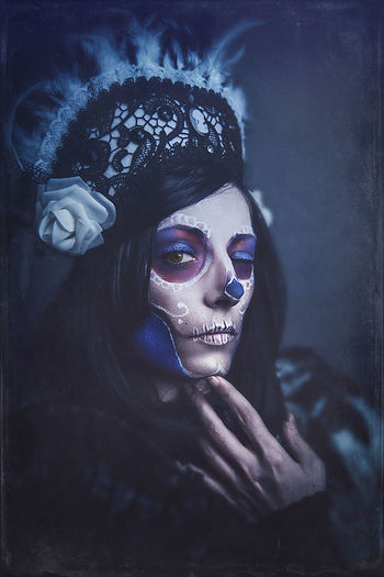 Halloween Adult Beautiful Woman Celebration Contemplation Costume Dayofthedead Diadelosmuertos Face Paint Headshot Human Face Indoors  Leisure Activity Lifestyles Looking At Camera Make-up Mid Adult One Person Paint Portrait Real People Skull Wink Winking Women Young Adult Young Women