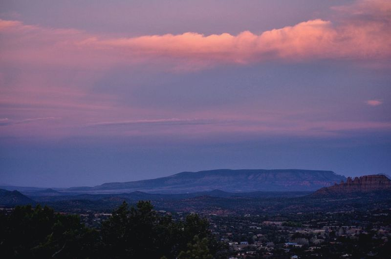 Hazy  Red Rocks  Sunrise And Clouds Sky Beauty In Nature Cloud - Sky No People Mountain Outdoors Scenics Nature Landscape Mountain Range Tree Day A New Beginning
