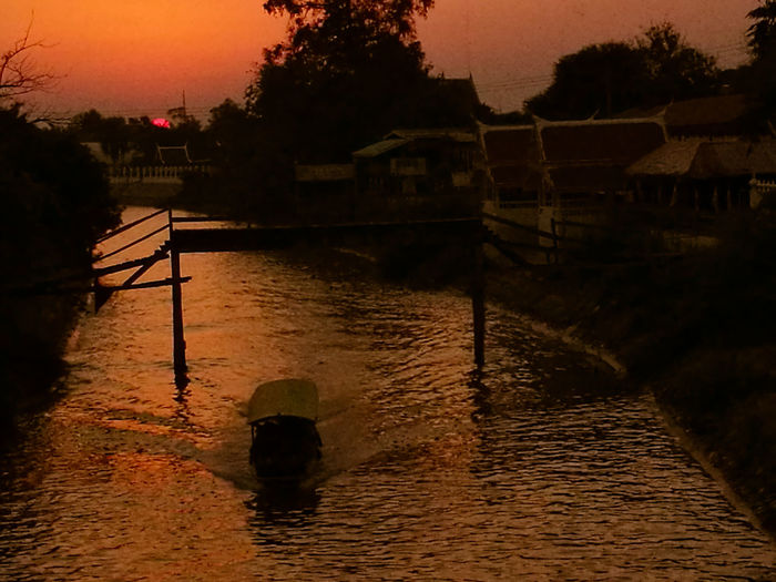 Boat in sunset @ Ayutthaya Water Reflection Sunset River Bridge - Man Made Structure Silence Travel Destinations Outdoors No People Night Sky Architecture City Nature City Life Civilization Thailand🇹🇭 Culture Boats⛵️ Traveling Sunlight Sunset_collection River View City Lights Cloud - Sky