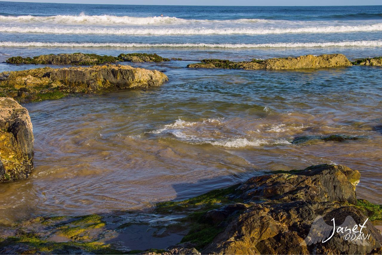 water, rock, sea, rock - object, solid, land, nature, motion, beach, beauty in nature, day, sport, scenics - nature, no people, wave, outdoors, aquatic sport, high angle view
