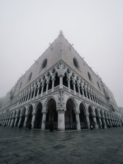 Early morning strolls through foggy Venice. Venice Venice, Italy Foggy Weather Week On Eyeem Italy Architecture Building Exterior Travel Destinations Building Architectural Column Travel Sky Low Angle View Courtyard  Olympus Wide Angle Built Structure History Religion Arch Façade Ancient Civilization Belief