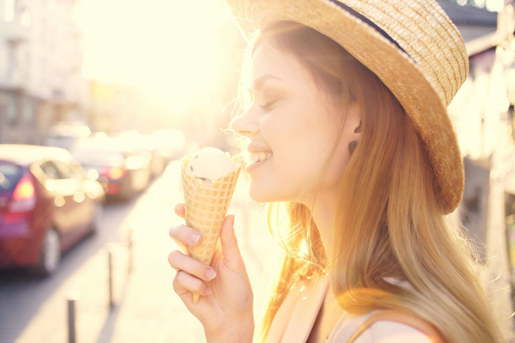 Portrait of young woman holding ice cream cone