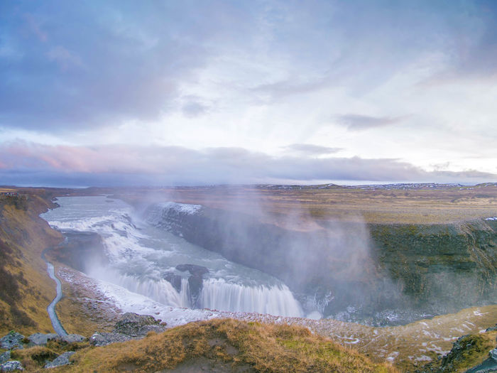 Cloud - Sky Beauty In Nature Scenics - Nature Environment Water Landscape Sky Nature Day Non-urban Scene Tranquil Scene No People Land Tranquility Geology Outdoors Idyllic Travel Destinations Steam Power In Nature Hot Spring Flowing Water Iceland Skogafoss
