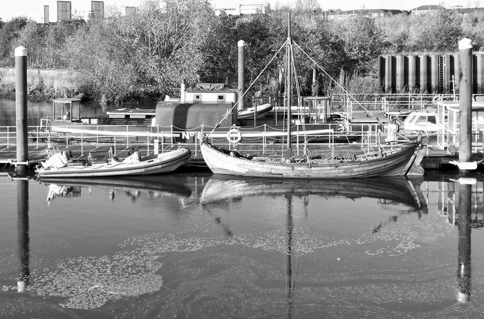 Water Reflection Nautical Vessel Moored Day Waterfront Outdoors No People Transportation Reflection Black And White Photography River Kelvin River Clyde Meeting Point Reflections In The Water