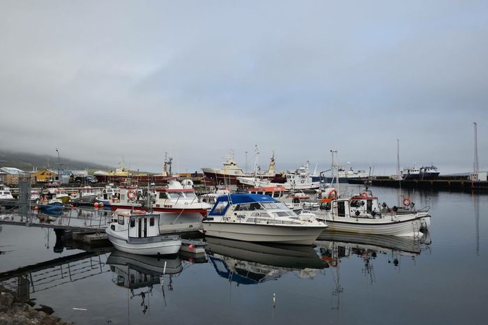 Husavik harbor, Iceland Nautical Vessel Transportation Moored Mode Of Transport Boat Water Harbor Sky Sea Waterfront Day Tranquility No People Cloud - Sky Ocean Iceland Reflection Still Life Still Water Reflections
