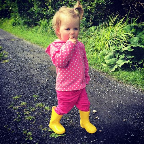 Toddler in yellow wellies out for a walk Wellies  Blond Hair Childhood Day Full Length Grass One Person Outdoors People Portrait Real People Toddler  Yellow Wellies