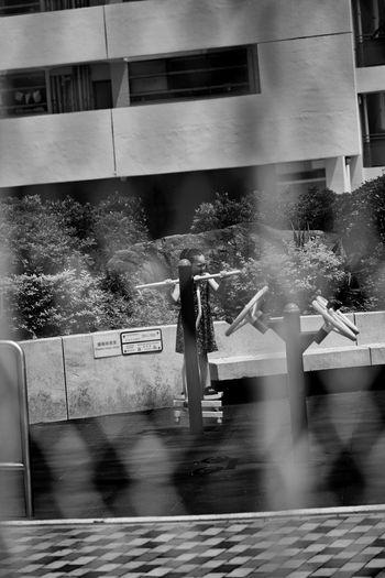 Digital composite image of people walking on street in city