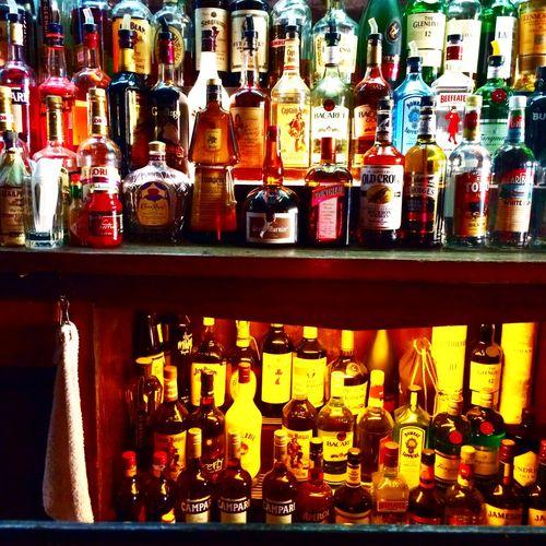 Full frame of bottles on shelf