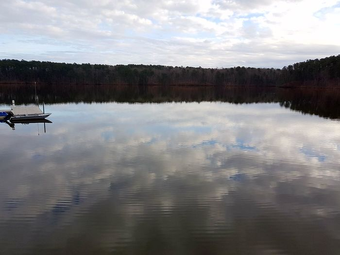 Water complements the sky Reflection Lake Nature Tranquility Beauty In Nature Trailrunning Mirrormirrorwithoutglass Skymeetswater Northcarolina Lakejohnson The City Light