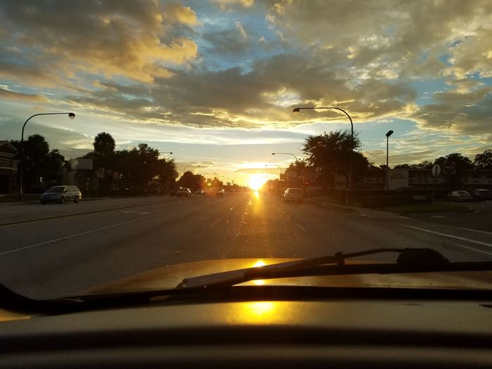 Mode Of Transport Land Vehicle Transportation Car Car Interior Road Sunset Windshield Street Vehicle Interior Sunlight Sunbeam Street Light On The Move Car Point Of View Sun Travel Transparent Sky Cloud - Sky No Edit/no Filter No Location Needed
