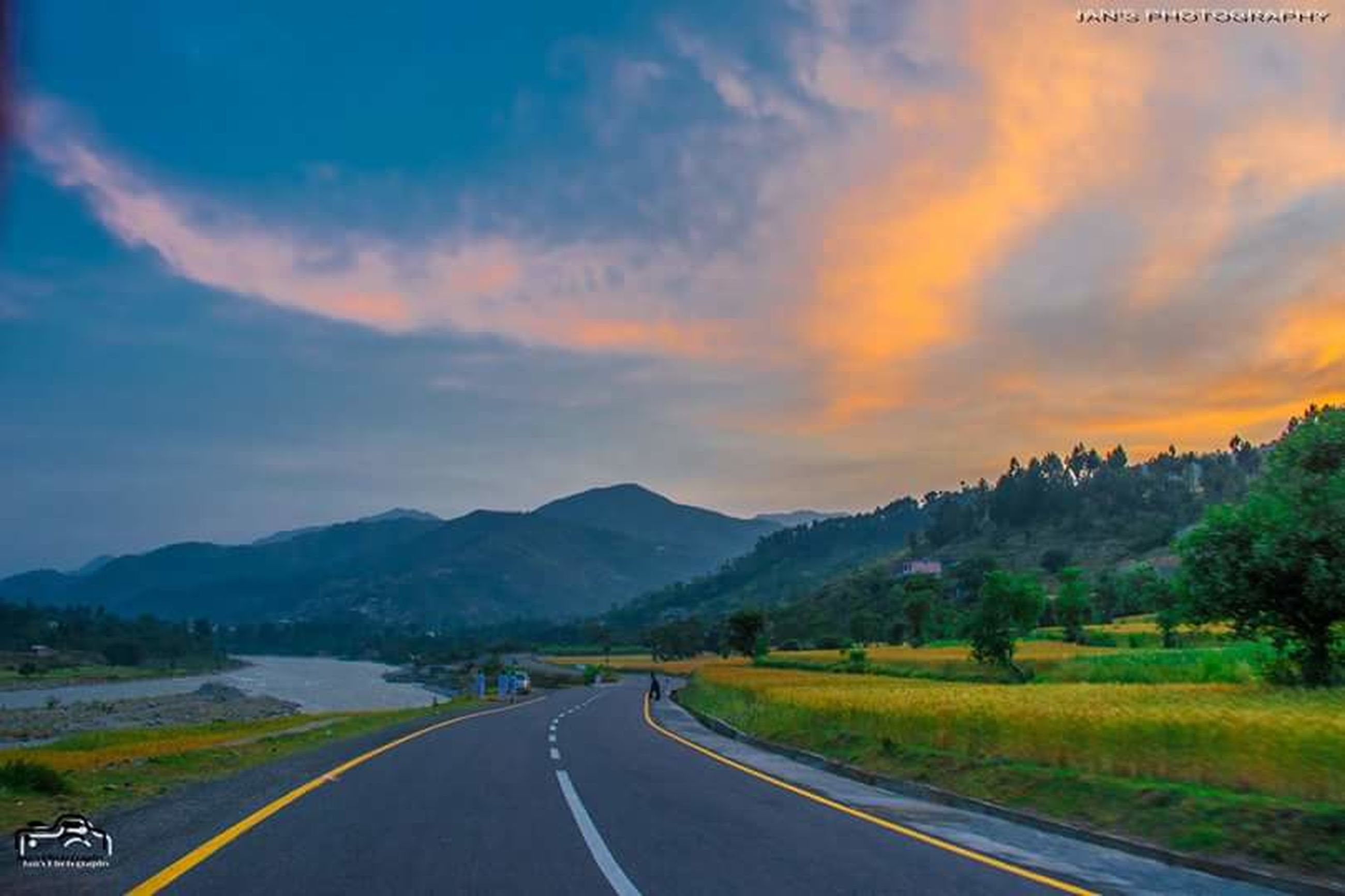 road, mountain, transportation, sky, the way forward, cloud - sky, landscape, mountain range, country road, road marking, scenics, tranquil scene, beauty in nature, tranquility, sunset, nature, diminishing perspective, cloud, car, vanishing point