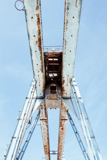 Blue Steel Abandoned Architecture Blue Bridge Building Exterior Built Structure Clear Sky Crane Day Directly Below Industry Low Angle View Machinery Metal Nature No People Outdoors Rusty Sky Tall - High Transportation The Architect - 2018 EyeEm Awards
