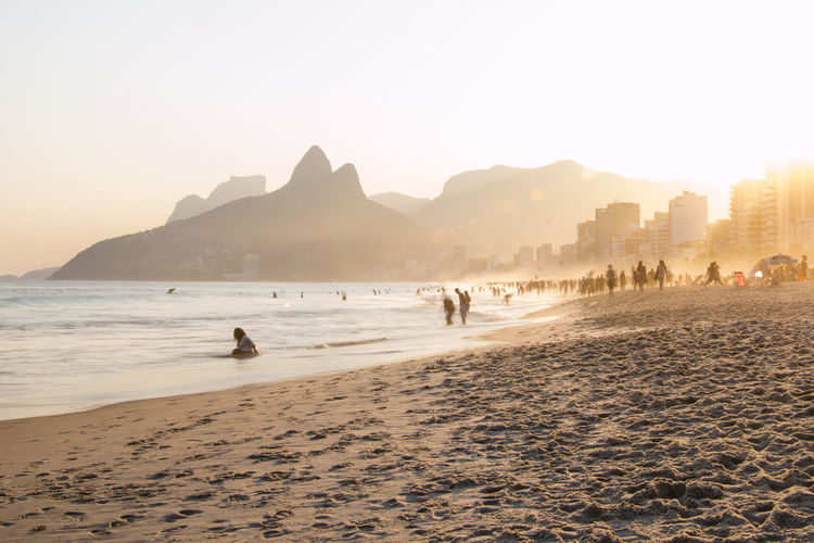 à la plage | Ipanema Beach Beach Enjoyment Leisure Activity Mountain Mountain Range Outdoors Relax Scenics Simple Life Sunset Tranquility Unrecognizable Person The Great Outdoors - 2017 EyeEm Awards The Street Photographer - 2017 EyeEm Awards